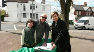 Green MP Caroline Lucas joins parents and pupils collecting petition signatures on the street